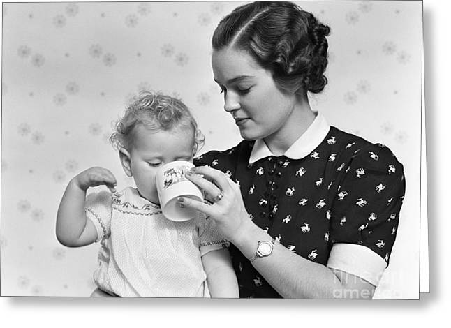 Caring Mother Greeting Cards - Mother Giving Baby Daughter Drink Greeting Card by H. Armstrong Roberts/ClassicStock