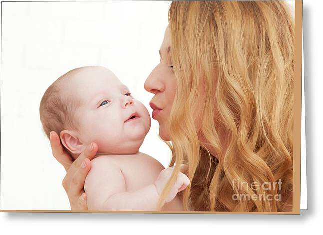 Mother Holding And Kissing Her Newborn Baby. Motherhood Greeting Card by Michal Bednarek