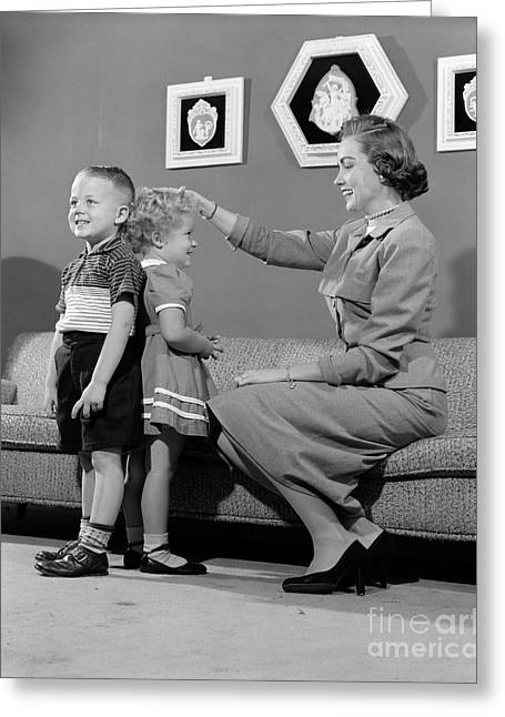 Caring Mother Greeting Cards - Mother Measuring Difference In Height Greeting Card by H. Armstrong Roberts/ClassicStock