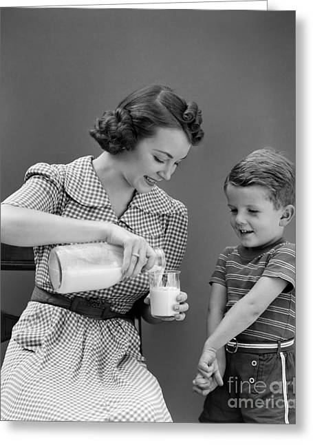Caring Mother Greeting Cards - Mother Pouring Glass Of Milk For Son Greeting Card by H. Armstrong Roberts/ClassicStock