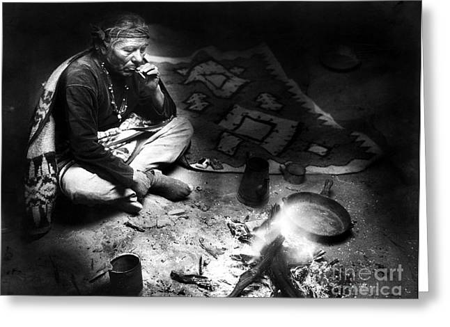 Early American Dwellings Greeting Cards - NAVAJO MAN SMOKING, c1915 Greeting Card by Granger