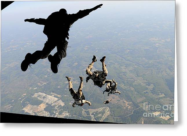 Drop Zone Greeting Cards - Navy Seals Jump From The Ramp Of A C-17 Greeting Card by Stocktrek Images