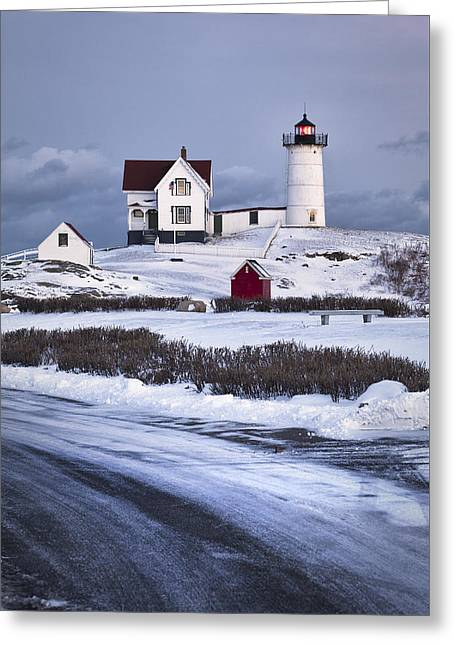 Nubble Lighthouse In The Snow Greeting Card by Eric Gendron