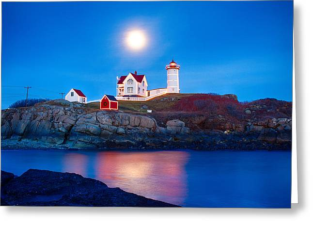 Cape Neddick Lighthouse Greeting Cards - Nubble Lighthouse lit for the season Greeting Card by Jeff Folger