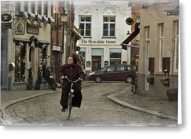 Nun On A Bicycle In Bruges Greeting Card by Joan Carroll