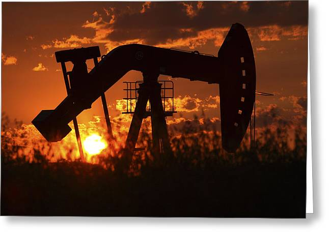 Prairie Landscape Greeting Cards - Oil rig pump jack silhouetted by setting sun Greeting Card by Mark Duffy