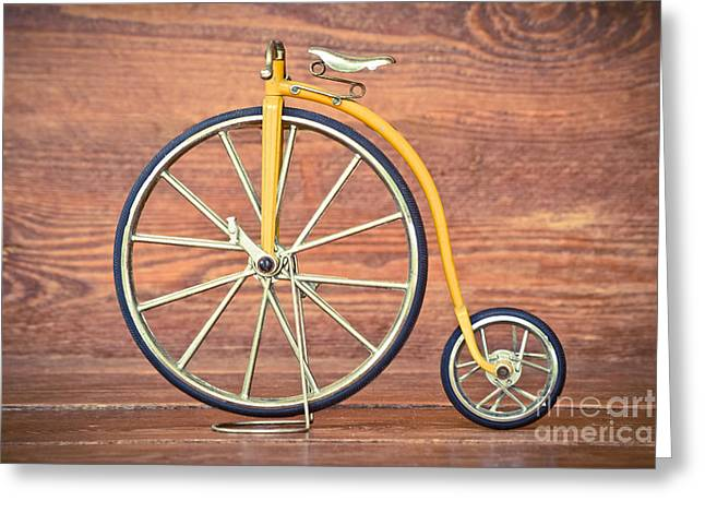 Victorian Greeting Cards - Old bike on a wooden surface. Greeting Card by Marc SOLERMARCE