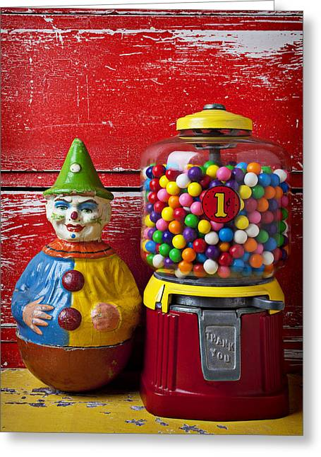 Costume Photographs Greeting Cards - Old clown toy and gum machine  Greeting Card by Garry Gay