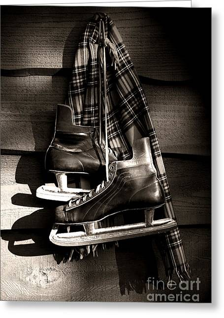 Sports Wear Greeting Cards - Old hockey skates with scarf hanging on a wall Greeting Card by Sandra Cunningham