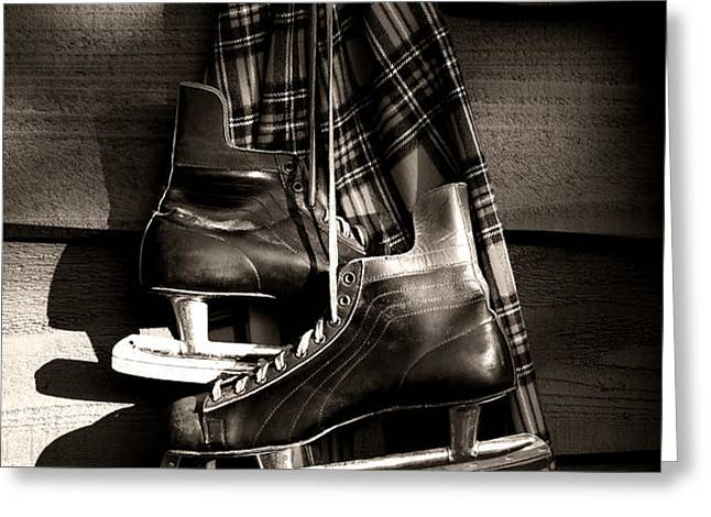 Old hockey skates with scarf hanging on a wall Greeting Card by Sandra Cunningham