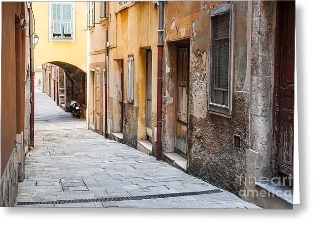 Old Town Village Greeting Cards - Old houses on narrow street in Villefranche-sur-Mer Greeting Card by Elena Elisseeva