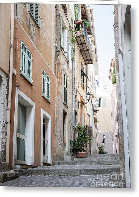 Southern Europe Greeting Cards - Old narrow street in Villefranche-sur-Mer Greeting Card by Elena Elisseeva