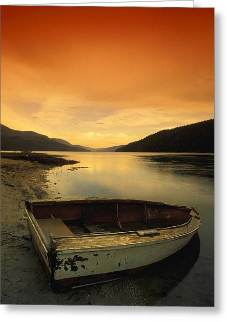 Evening Wear Photographs Greeting Cards - Old Rowboat At Waters Edge With Sunset Greeting Card by Don Hammond