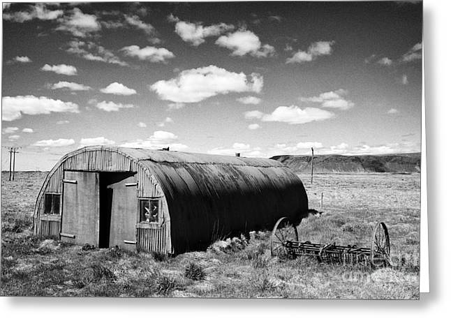 Outbuildings Greeting Cards - Old Rusting Nissen Hut Outbuilding On Farmland At Hraungerdi Southern Iceland Greeting Card by Joe Fox