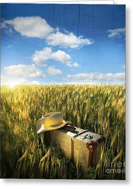 Old Suitcase With Straw Hat In Field Greeting Card by Sandra Cunningham