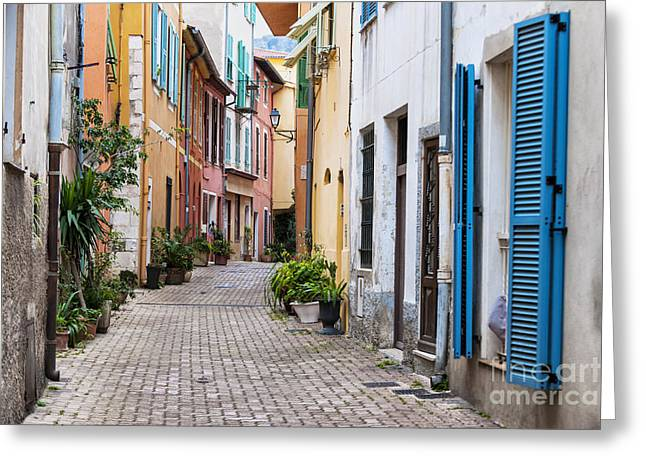 Emerald Coast Greeting Cards - Old town street in Villefranche-sur-Mer Greeting Card by Elena Elisseeva