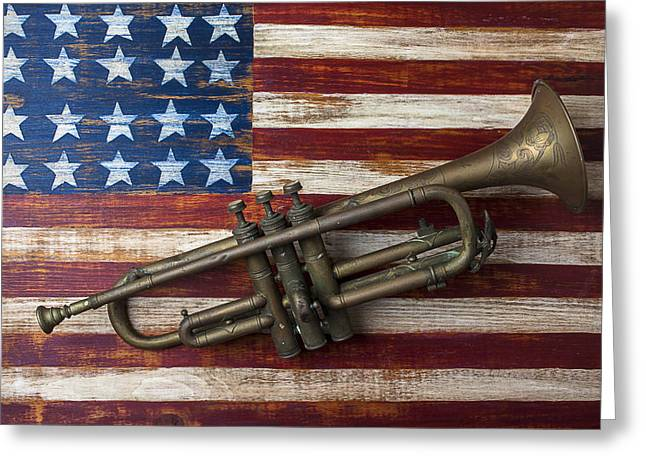 Concept Photographs Greeting Cards - Old trumpet on American flag Greeting Card by Garry Gay