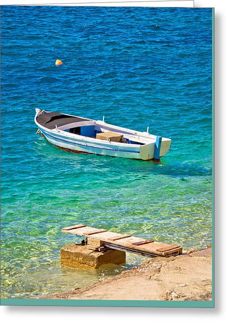 Fishing Boats Greeting Cards - Old wooden fishermen boat on turquoise beach Greeting Card by Dalibor Brlek