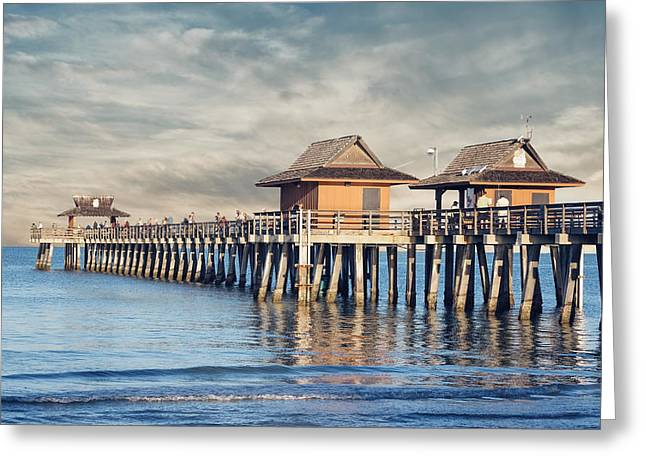 On The Beach Greeting Cards - On A Cloudy Day at Naples Pier Greeting Card by Kim Hojnacki