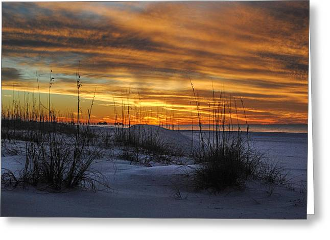Orange Clouded Sunrise over the Pier Greeting Card by Michael Thomas