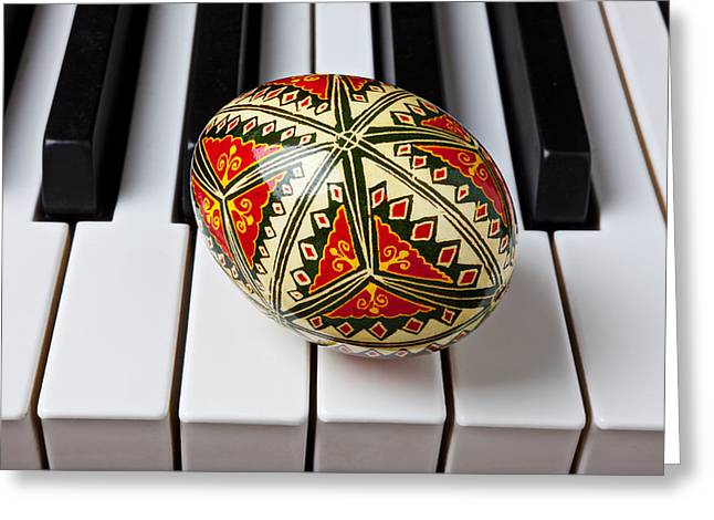 Keyboard Photographs Greeting Cards - Painted Easter egg on piano keys Greeting Card by Garry Gay