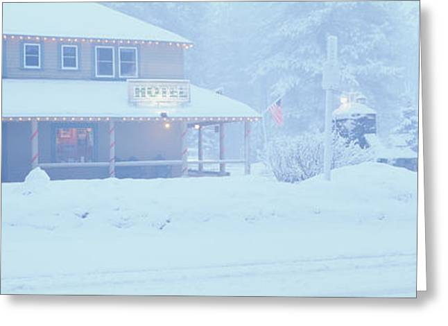 Small Towns Greeting Cards - Pale Hotel In Winter Snowstorm, Lake Greeting Card by Panoramic Images