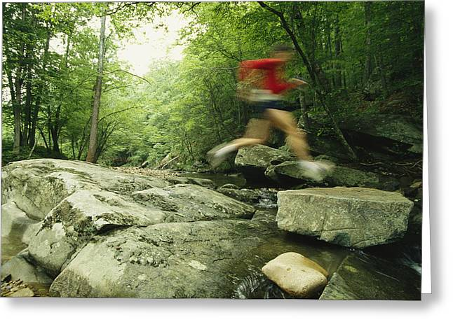 Sportswear Greeting Cards - Panned View Of Man Leaping Over Rocky Greeting Card by Skip Brown