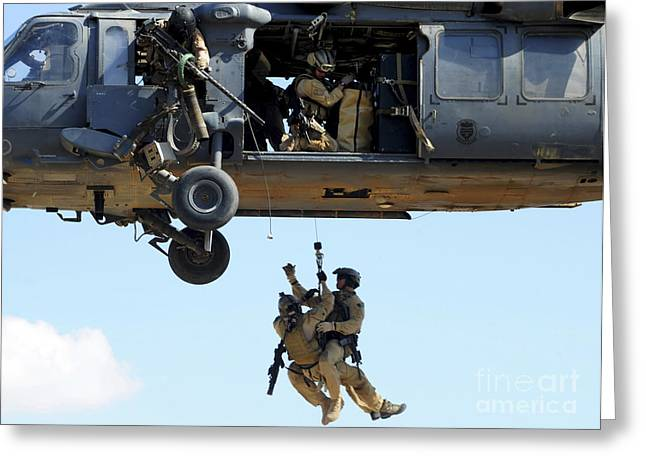 Baghdad Greeting Cards - Pararescuemen Are Hoisted Into An Hh-60 Greeting Card by Stocktrek Images