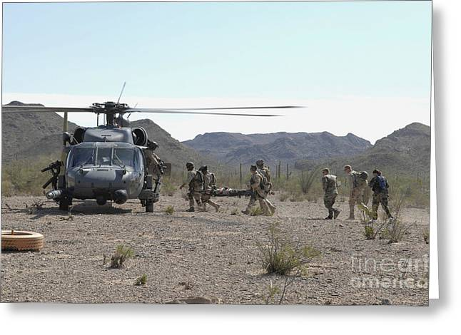 Assistance Greeting Cards - Pararescuemen Transport Rescuees To An Greeting Card by Stocktrek Images