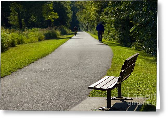 Park Bench And Person On Walking Trail Photo Greeting Card by Paul Velgos