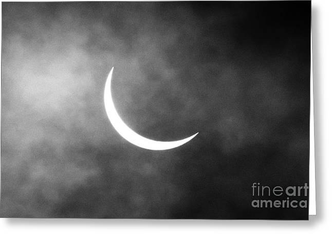 Partial Greeting Cards - Partial solar eclipse as seen through cloud Greeting Card by Joe Fox