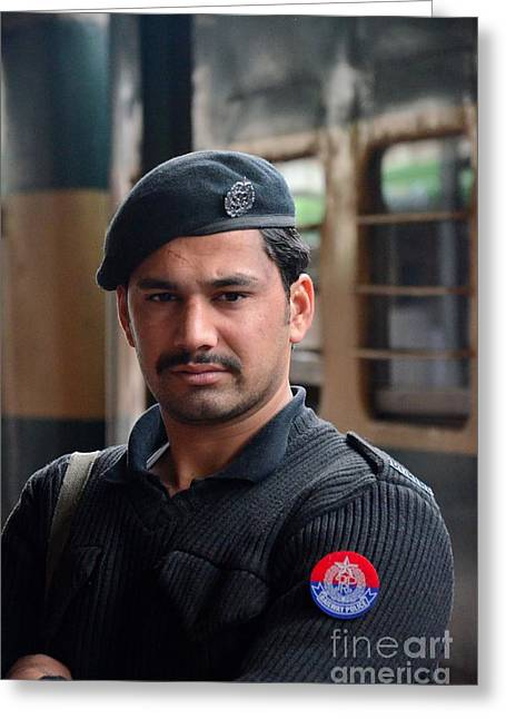 Police Officer Greeting Cards - Pashtun Railway Police officer stands guard at train Station Peshawar Pakistan Greeting Card by Imran Ahmed