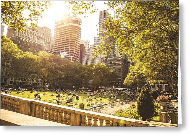 Bryant Greeting Cards - People chilling in Bryant Park New York Greeting Card by Leonardo Patrizi