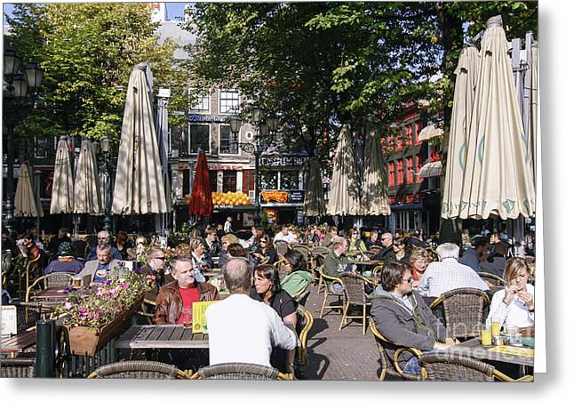 Coffee Drinking Greeting Cards - People enjoying s sunny day in Amsterdam Greeting Card by Patricia Hofmeester