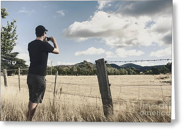 Taking Photographs Greeting Cards - Person taking photograph of a Tasmanian landscape Greeting Card by Ryan Jorgensen