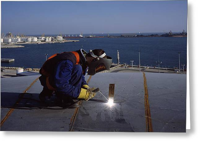 Person Welding In A Chemical Plant Greeting Card by Panoramic Images