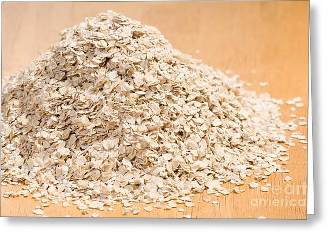 Porridge Greeting Cards - Pile of dried rolled oat flakes spilled  Greeting Card by Arletta Cwalina