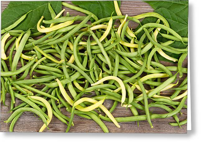 Green Beans Greeting Cards - Pile of green and yellow beans on rustic wooden boards Greeting Card by Tom  Baker