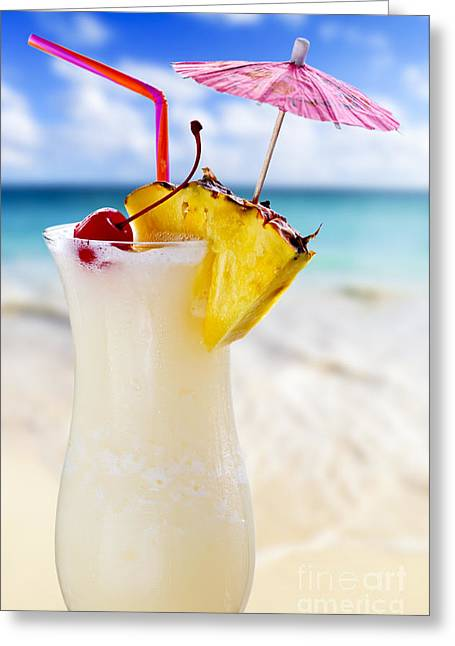 White Photographs Greeting Cards - Pina colada cocktail on the beach Greeting Card by Elena Elisseeva