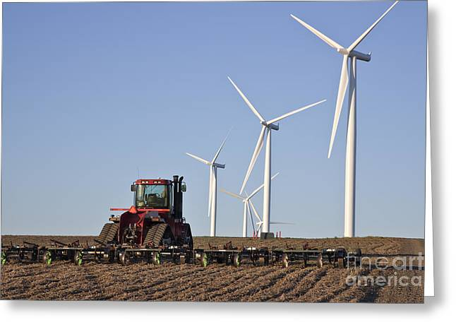 Harrow Greeting Cards - Plowing Field On Wind Farm Greeting Card by Inga Spence