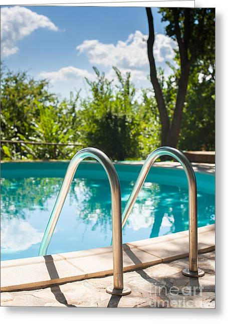 Swim Ladder Greeting Cards - Pool ladder close up on swimming pool Greeting Card by Fabio Pagani