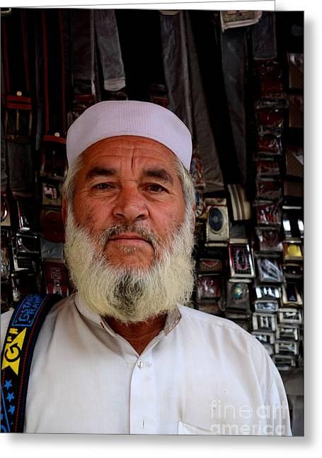 Straps Greeting Cards - Portrait of Pashtun Pakistani man posing outside belt shop Empress Market Karachi Greeting Card by Imran Ahmed