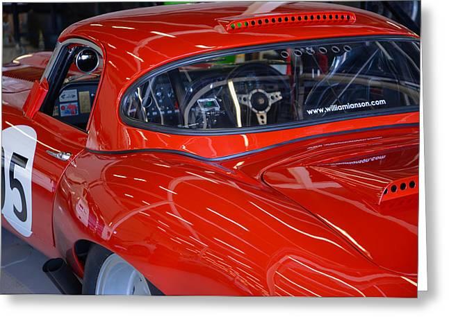 Jaguars Greeting Cards - Racing red Jaguar  Greeting Card by Graham Smith