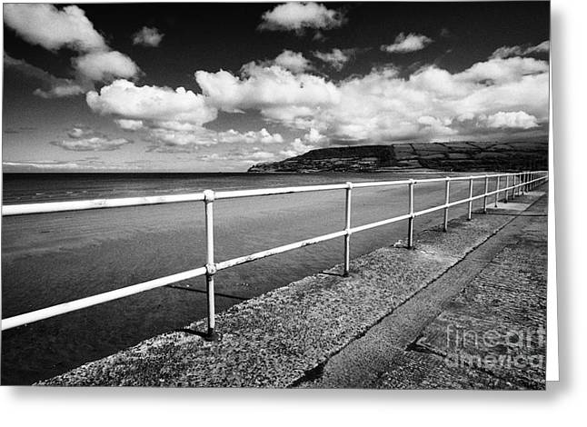 Walk Paths Greeting Cards - railings along seafront at Carnlough beach County Antrim Northern Ireland UK Greeting Card by Joe Fox