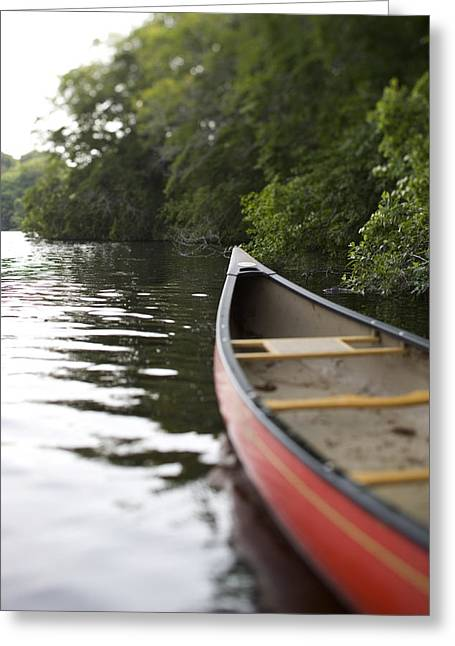 Canoe Photographs Greeting Cards - Red Canoe At Shoreline With Trees Greeting Card by Ink and Main