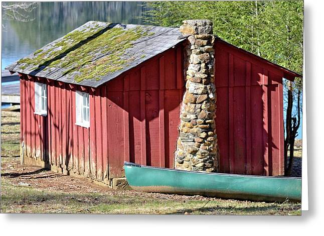 Red Shed And Canoe Greeting Card by Susan Leggett