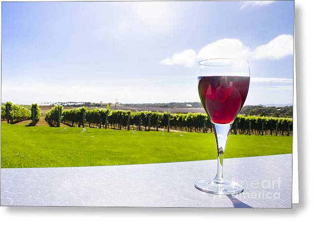 Table Wine Greeting Cards - Red wine glass at Tasmania countryside winery Greeting Card by Ryan Jorgensen