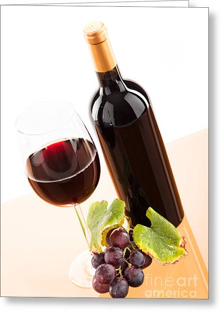 Drink Greeting Cards - Red wine in glass with bottle and wine grapes Greeting Card by Wolfgang Steiner