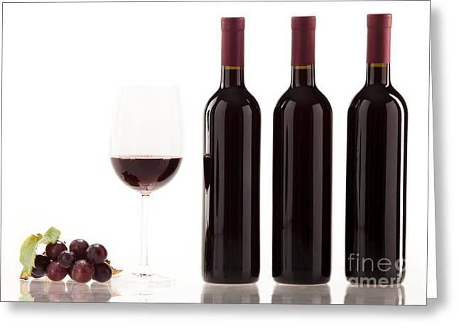 Beverage Greeting Cards - Red wine in glass with fruit leaves and wine bottle Greeting Card by Wolfgang Steiner