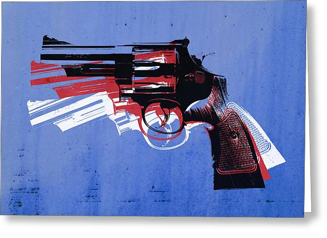 Revolver On Blue Greeting Card by Michael Tompsett